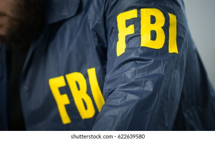 FBI agent in his office in uniform, part of