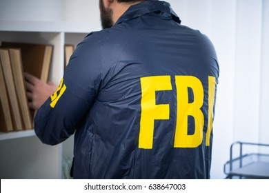 FBI agent in his office wearing a uniform, rear view