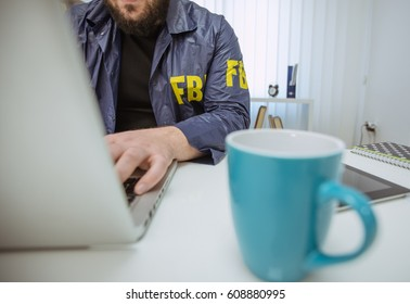 FBI agent man working in his office on laptop, part of