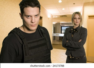 fbi agent in office wearing bullet proofed jacket