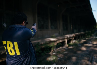 FBI agent using a gun