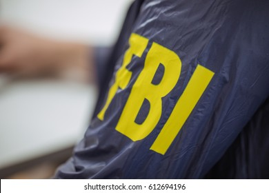 FBI agent wearing FBI uniform, part of