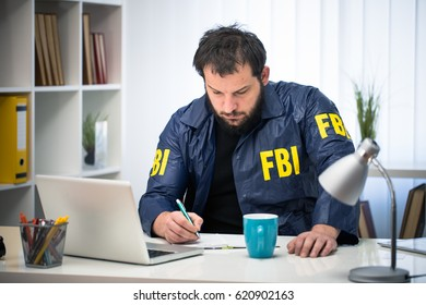 FBI working hard in his office alone