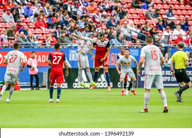FC Dallas Matt Hedges (24) and New York Red Bulls Brian White (42) attempt to head the ball during a MLS match a between the New York Red Bulls and FC Dallas 5/11/19, at Toyota Stadium, Frisco, TX