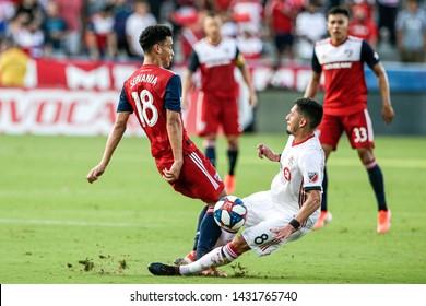 FC Dallas midfielder Brandon Servania (18) and Toronto FC midfielder Marco Delgado (8) collide during a MLS match a between Toronto FC and FC Dallas June 22, 2019, at Toyota Stadium, Frisco, Texas.