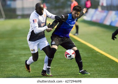 FC Edmonton #11 Dustin Corea and Puerto Rico FC #21 Michael Kafari Challenge  in the NASL Match between FC Edmonton and Puerto Rico FC at Clarke Field, Edmonton, Alberta, Canada Apr  22,  2017