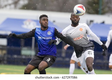 Fc Edmonton #3 Allan Zebie and Purto Rico Fc #21 Michaell Kafari chase down the ball in the NASL Match between FC Edmonton and Puerto Rico FC at Clarke Field, Edmonton, Alberta, Canada