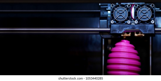 FDM 3D-printer manufacturing wound pink easter egg sculpture - front view on object and print head - panel type composition - background blanked out blurry