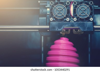 FDM 3D-printer manufacturing wound pink easter egg sculpture - front view on object and print head - bright sunny matte look - background blanked out blurry