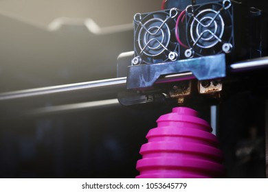 FDM 3D-printer manufacturing wound pink easter egg sculpture - close up of object and print head - bright sunny light mood - background blanked out blurry