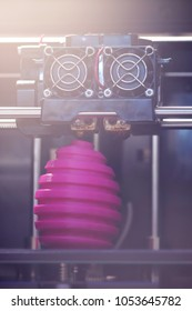 FDM 3D-printer manufacturing wound pink easter egg sculpture - front view on object and print head - portrait composition in bright sunny light mood - background blanked out blurry
