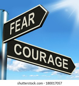 Fear Courage Signpost Showing Scared Or Courageous