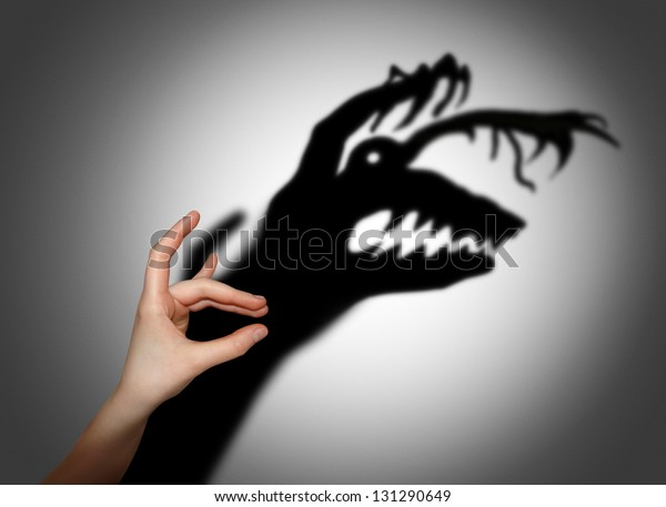 Fear, fright, shadow on the wall
