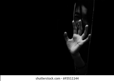 fear girl hiding in closet with hand reaching out  in white tone