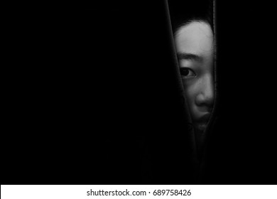 fear girl hiding in closet in white tone
