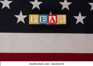 Fear.  Fear spelled out in letter blocks on top of the American flag.