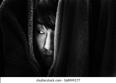 fear woman hide behind cloth with shadow edge