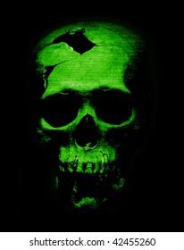 Fearful destroyed human skull in green light, looks like alien skull.