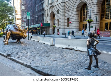 Fearless girl facing Charging Bull at Manhattan, New York, NY, USA on the July 31, 2017