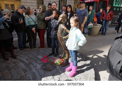 Fearless Girl Statue Erected for Women's Day With Two Girls Posing In Downtown Manhattan, New York City March 9, 2017