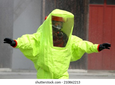 fearless rescuer with the yellow suit against biological hazard from contamination