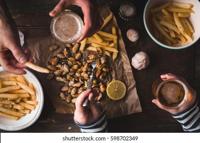 Feast with beer, mussels, fried potatoes