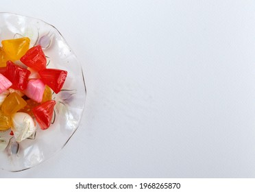 Feast Concept, Traditional Turkish Ramadan sweet sugar candy, colorful akide sekeri  in glass bowl, with copy space for text.
