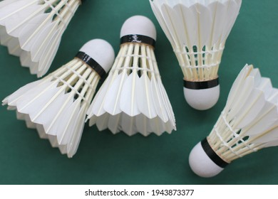 Feather badminton shuttlecock on the court