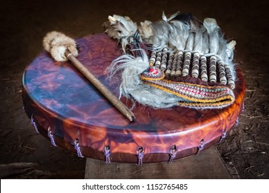 Feather headdress, ancient amerindian leather tambourine and drum drumstick. Attributes of the ancient american indian