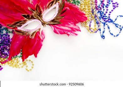 feather mask and beads for mardi gras