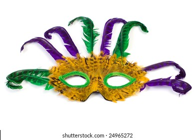 A feather masquerade mask, isolated against a white background