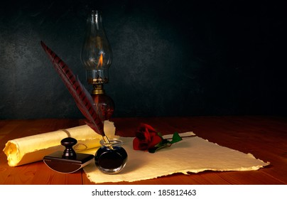 Feather pen and ink with kerosene lamp