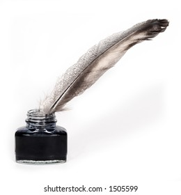 feather quill and inkwell over white background