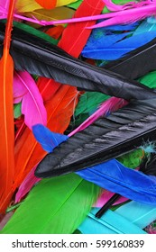 Feathers texture. Beautiful colored vibrant bird feather photo as background. Colorful feather pattern.