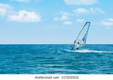 FEB 10, 2013 Phuket, THAILAND - Phuket Patong beach windsurfing sport in hot summer sun, tropical island  turqouise water activity