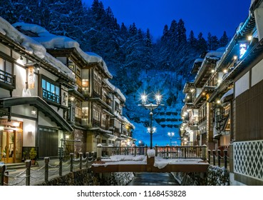 Feb. 10, 2016. Night view of the winter Ginzan onsen Hot Spring area in Yamagata, Japan. Elegant wooden hotels stand in rows on both sides of the Ginzan River. (PS:all non-English texts are hotels)