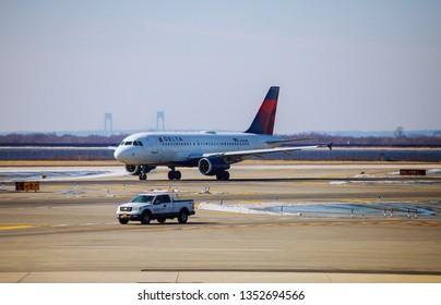 FEB 14, 2019 JFK NEW YORK, USA: Airplane at the terminal gate ready for takeoff JFK international airport during travel