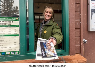 FEB 14, BRYCE NAT PARK, UTAH, USA - Female blond National Park Ranger hands out brochure through window at Bryce National Park, Utah