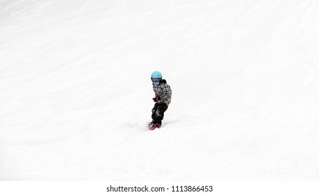 FEB 17, 2018 IWATE, JAPAN : Asian children snowboarder is riding with snowboard from powder snow hill