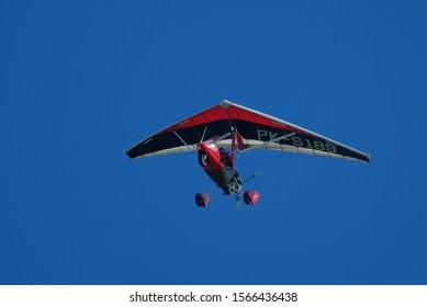 Feb 17, 2018. Yogyakarta, Indonesia. Microlight aircraft fly high into the blue sky.