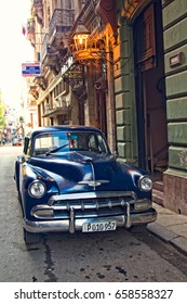 FEB. 18, 2017- HAVANA, CUBA - A blue vintage car parked on a city street in Havana, Cuba