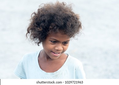 Feb 18, 2018 Aeta child with a shy smile looking at tourists, Capas, Philippines