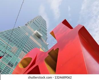 Feb 19 2018: Taipei, Taiwan: Modern art at skyline of taipei 101 tower and love message. Downtown Taipei with Taipei 101 Skyscraper, capital city of Taiwan