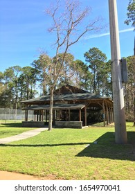 Feb 23, 2020 at crossing park on Hilton head island South Carolina USA. The picture of batting cages old but steady building on the green field and palmetto trees in the back with bright blue sky.