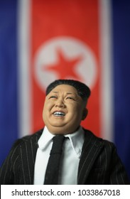 FEB 25 2018: Caricature of North Korean Supreme Leader Kim Jong Un in front of the flag of the Democratic People's Republic of Korea - 1:6 scale reproduction action figure