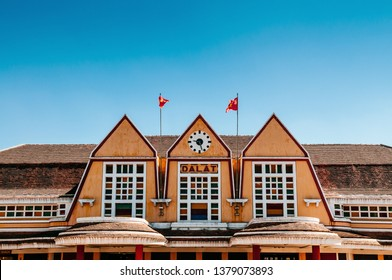 FEB 26, 2014 Dalat, Vietnam - Old Dalat railway station. French colonial style building with yellow facade, Station was designed in 1932 by French architects Moncet and Reveron.