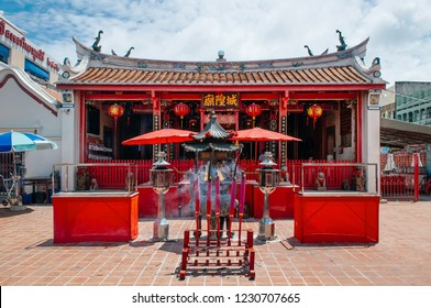 FEB 28, 2013 Songkhla, THAILAND - Prayer place and inscent sticks at old historic building of Songkhla city pillar shrine with Chinese architecture on Nang Ngam street historic district in summer.