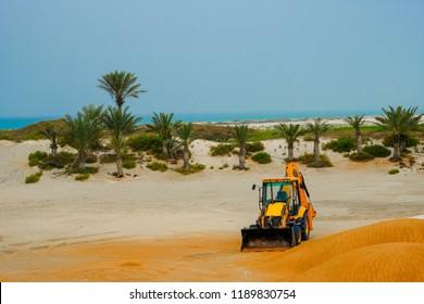 Feb: 28, 2018: JCB Backhoe Construction Equipment abandoned in Desert area near Saadiyat Island Abu Dhabi, UAE