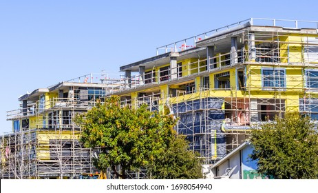 Feb 3, 2020 Mountain View / CA / USA - Multifamily residential building under construction; the entire Silicon Valley and the San Francisco Bay is facing a housing crisis, with increased housing costs
