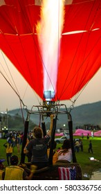 Feb,14 - 2017. Chiang Rai, Thailand. Balloon pilot is blasting valve of the burner to fill up the balloon to make it rises. Singhapark International Balloon Fiesta 2017